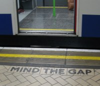 mind the gap, district line platform, victoria station, london underground